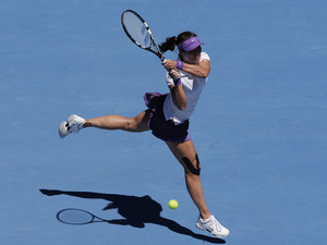 China's Li Na hits a backhand return in her semifinal match against Maria Sharapova at the Australian Open tennis championship on January 24, 2013