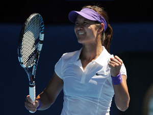 China's Li Na celebrates after defeating Maria Sharapova in the semifinal of the Australian Open tennis championship on January 24, 2013