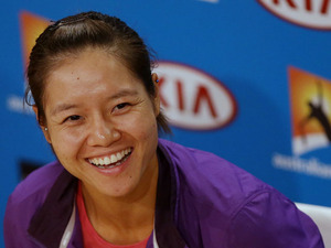 China's Li Na smiles during a press conference ahead of the final of the Australian Open tennis championship on January 25, 2013