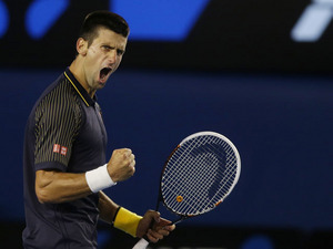 Serbia's Novak Djokovic celebrates winning the second set of the men's final at the Australian Open tennis championship on January 27, 2013