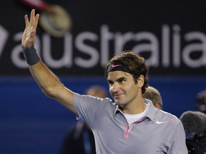 Roger Federer waves to the crowd after his fourth round victory over Milos Raonic at the Australian Open tennis championship on January 21, 2013
