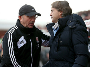 Stoke City manager Tony Pulis and Manchester City manager Roberto Mancini shake hands prior to kick off on January 26, 2012
