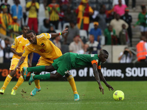 Zambia's Chisamba Lungu is challenged by Ethiopia's Adane Girma during their teams match at the African Cup of Nations on January 21, 2013