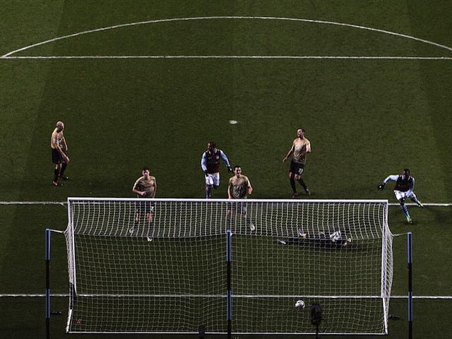 Villa striker Christian Benteke opens the scoring against Bradford on January 22, 2013