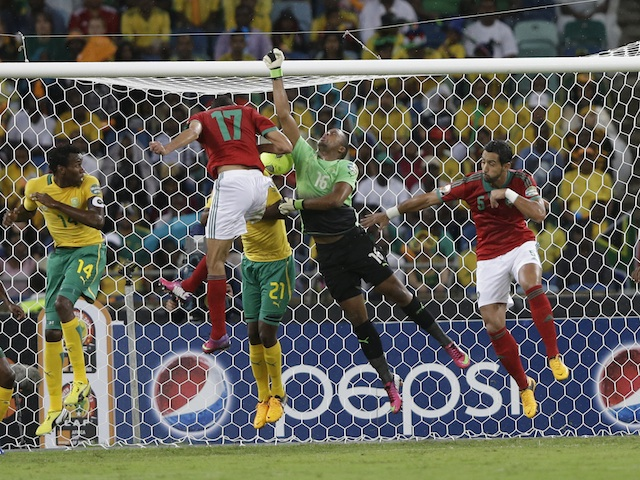 Morocco's Issam El Adoua heads a goal against South Africa on Janauary 27, 2013