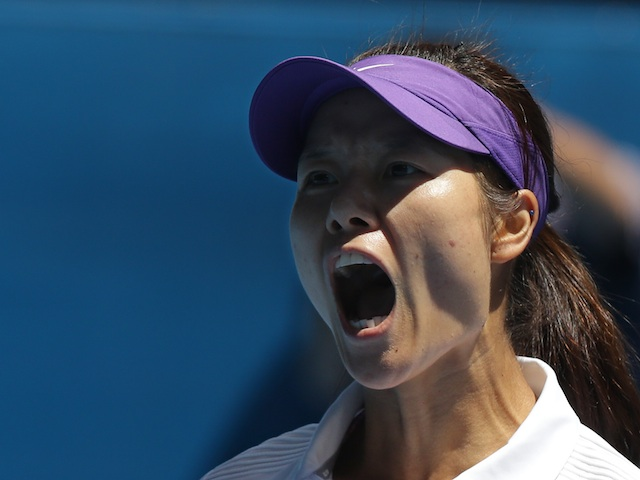 China's Li Na reacts during her quarter-final against Agnieszka Radwanska on January 22, 2013