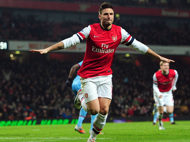 Olivier Giroud celebrates scoring his second and his team's fifth goal against West Ham on January 23, 2013