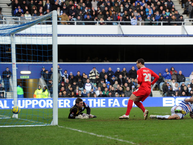 MK Dons player Ryan Harley scores the third goal during his sides FA Cup fourth round tie with QPR on January 26, 2013