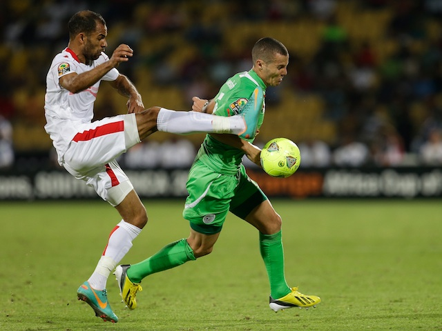 Tunisia's Saber Khalifa fights for the ball with Algeria's Djamel Mesbah during their ACON match on January 22, 2013