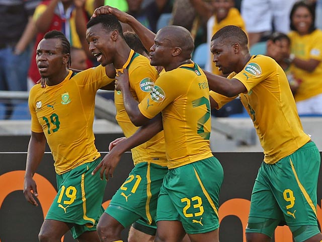 South Africa's Siyabonga Sangweni is congratulated by team mates after scoring the opener in the Africa Cup of Nations match against Angola on January 23, 2013