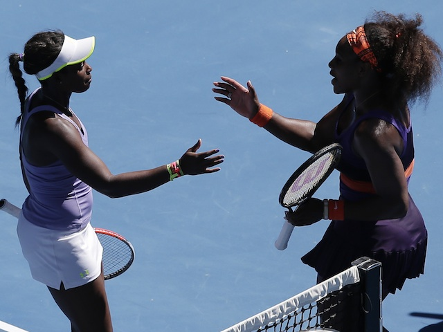 Serena Williams congratulates Sloane Stephens following their quarter-final match on January 23, 2013