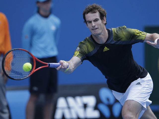 Britain's Andy Murray hits a forehand return during his fourth round match with Gilles Simon at the Australian Open tennis championship on January 21, 2013