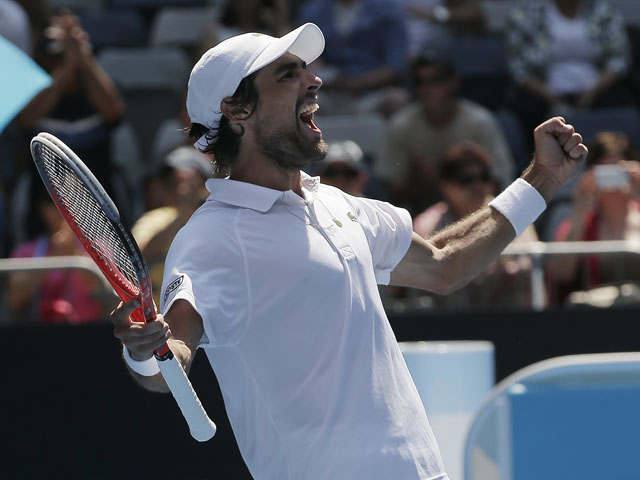 France's Jeremy Chardy celebrates winning hiss fourth round match against Andreas Seppi at the Australian Open tennis championship on January 21, 2013