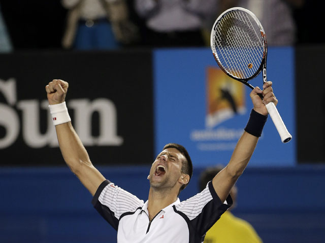 Novak Djokovic celebrates defeating Tomas Berdych at the Australian Open tennis championship on January 22, 2013