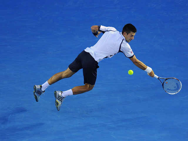 Novak Djokovic in action during his quarterfinal match  at the Australian Open tennis championship on January 22, 2013