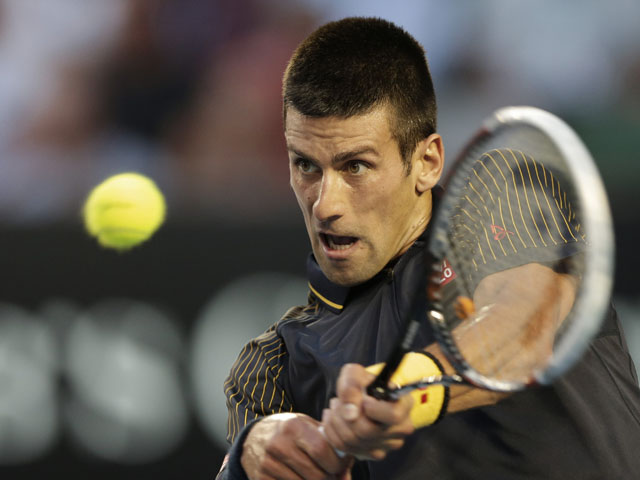 Serbia's Novak Djokovic in action against David Ferrer during their semifinal match at the Australian Open tennis championship on January 24, 2013