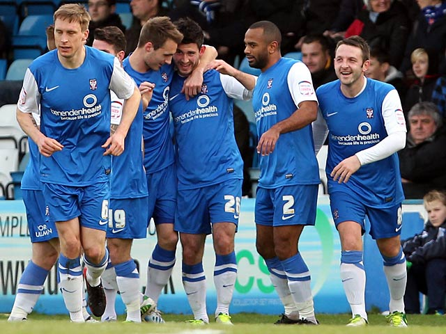 York City players celebrate after opposition Gillingham's Charlie Lee scores an own goal on January 26, 2013
