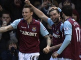 West Ham's Andy Carroll celebrates with teammates after giving his side the lead against Swansea on February 2, 2013