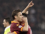 AS Roma forward Francesco Totti celebrates with a teammate after scoring in his sides match with Cagliari on February 1, 2013