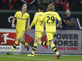 Borussia Dortmund player Marco Reus celebrates with teammates after scoring on February 3, 2013