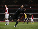 Liverpool's Luis Suarez celebrates after giving his team the lead against Arsenal on January 30, 2013