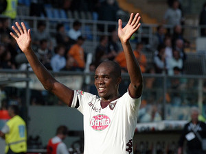 Torino's Angelo Ogbonna waves to the fans on September 30, 2012