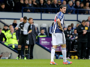 Goran Popov makes his way off the field after being shown a straight red card in the match against Tottenham on February 3, 2013