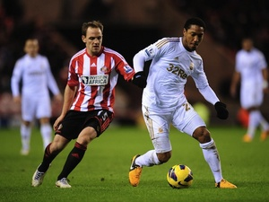 Swansea's Jonathan de Guzman shields the ball from Sunderland's David Vaughan on January 29, 2013