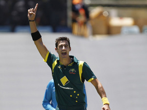 Australia's Mitchell Starc celebrates taking the wick of West Indies player Jason Holder during their team's one day international on February 1, 2013