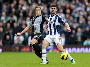 Shane Long and Michael Dawson battle for the ball on February 3, 2013
