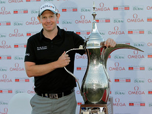 Stephen Gallacher poses with the trophy after winning the Dubai Desert Classic Golf tournament in Dubai on February 3, 2013