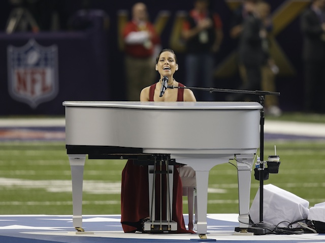 Alicia Keys sings the national anthem before the Superbowl on February 3, 2013