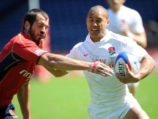 England player Dan Caprice fends off a challenge during his side's match with Spain on May 28, 2011