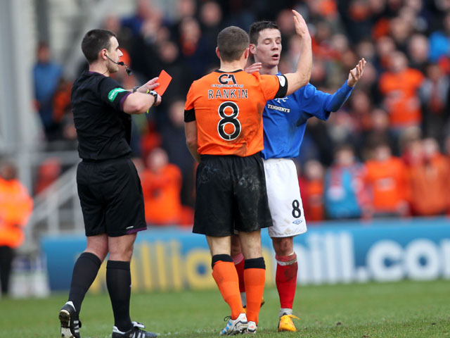 Rangers player Ian Black is shown a red card in his side's match with Dundee United on February 2, 2012