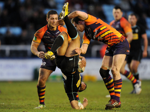 London Broncos' Keiran Dixon tackled by Widnes Vikings' Joe Mellor during the side's match on February 3, 2013