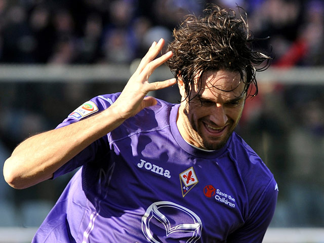 Fiorentina's Luca Toni celebrates scoring the opening goal against Parma on February 3, 2013