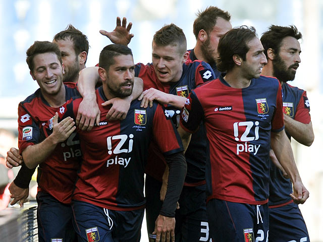 Genoa's Marco Borriello is congratulated by team mates after scoring the opening goal against Lazio on February 3, 2013