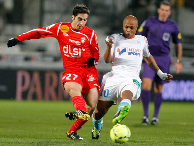 Nancy player Thomas Ayasse and Marseille forward Andre Ayew challenge for the ball in their team's clash on February 3, 2013
