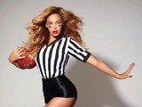 Beyonce posing with a ball in a Super Bowl promo shot