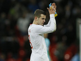 England player Jack Wilshere applauds the fans after his side's match with Brazil on February 6, 2013