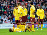 Arsenal's Jack Wilshere lays injured while teammates look on during his side's game with Sunderland on February 9, 2013