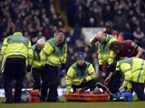 Newcastle's Yoan Gouffran is tended to after being injured against Tottenham on February 9, 2013