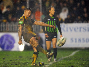 Castleford Tigers' Jamie Ellis kicks the winning penalty during the match against Leeds Rhinos on February 10, 2013