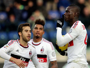 Milan's Mario Balotelli celebrates with team mates after scoring the equaliser against Cagliari on February 10, 2013