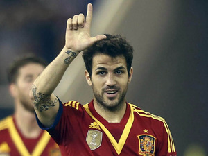 Spain's Cesc Fabregas celebrates scoring against Uruguay on February 6, 2013
