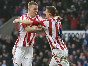 Robert Huth celebrates with his Stoke City teammate after scoring against Reading on February 9, 2013