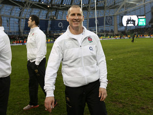 England coach Stuart Lancaster smiles at the end of his team's match after beating Ireland in the Six Nations on February 10, 2013