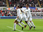 Swansea City's Angel Rangel celebrates alongside teammates after he scored against QPR on February 9, 2013