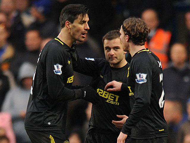 Shaun Maloney (centre) celebrates with his Wigan teammates after scoring against Chelsea on February 9, 2013