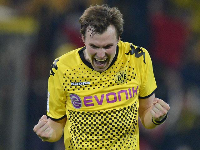 Dortmund player Kevin Grosskreutz celebrates after his side's match with Bayern Munich on April 11, 2012